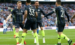 Kevin De Bruyne (left) celebrates after setting up Gabriel Jesus for his early goal against Brighton.