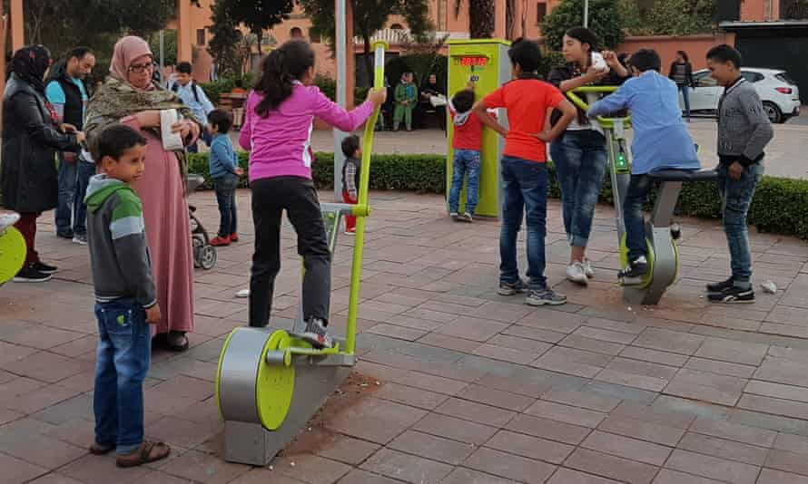 Power cycle: Marrakech residents try out a green energy outdoor gym.