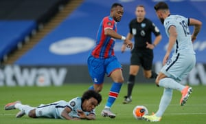 Palace's Jordan Ayew vies for possession with Chelsea's Willian and Olivier Giroud.