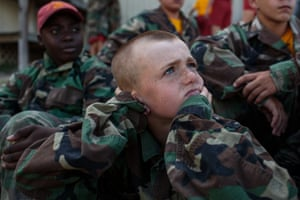 """Marine Military Academy summer camp in Harlingen, TX.Marine Military Academy, an all-boys institution, hosts a summer camp on their academic campus in Harlingen, Texas, 17 July 2017. The camp hosts boys from around the world, ages 12-18, with around 300 cadets in attendance.Marine Military Academy photograph:In Harlingen, Texas, a group of young boys lolls on the grass in the sunshine, swapping their families war stories. """"My uncle killed Taliban in Afghanistan,"""" one boy says. Another shares a tale about a relative who tried to smuggle an AK-47 back to the U.S. The boys will spend a few more weeks at this private quasi-military camp where they will engage in physical, mental and weapons training. Some of them dream of a career in the U.S. Army, Air Force, Navy or Marine Corps. Marine Military Academy summer camp, Harlingen, Texas."""
