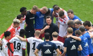 Hamburg's coach Christian Titz talks to the team after confirmation of their relegation