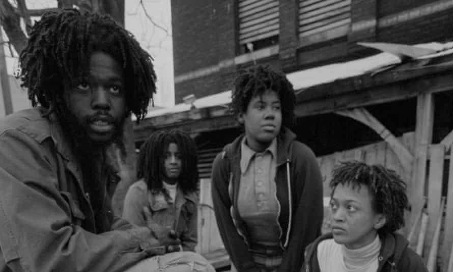 Delbert Africa and other members of Move, an organisation founded by John Africa, sit in front of their barricaded house in the Powelton Village section of Philadelphia.