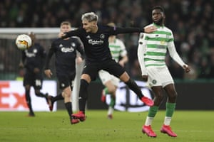 Copenhagen's Guillermo Varela (left) vies for the ball with Celtic's Odsonne Édouard during their Europa League match at Celtic Park in February 2020