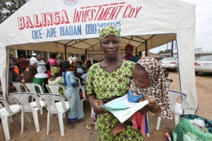 Bukola Akami holds up her client intake form during the PPFN outreach programme at the Eni Ayo clinic