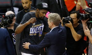 Kerr celebrates with Kevin Durant after the Warriors beat the Rockets in the Western Conference final.