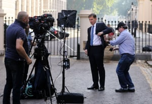 Hunt gets ready for an interview outside 1 Carlton House Terrace in central London