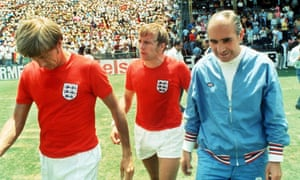 Sir Alf Ramsey leaves the field with Colin Bell and Francis Lee after England's 3-2 defeat by West Germany in the 1970 quarter-finals
