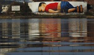 A huge graffiti artwork of Alan Kurdi by German artists Justus Becker and Oguz Sen on the banks of Main river near European Central Bank HQ in Frankfurt.