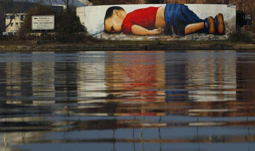 A huge graffiti artwork of Alan Kurdi by German artists Justus Becker and Oguz Sen on the banks of Main river near European Central Bank HQ in Frankfurt.