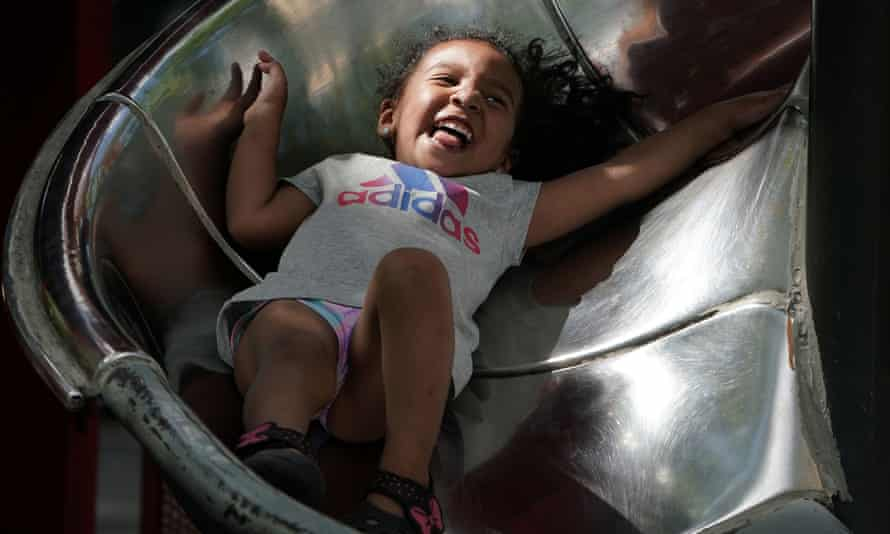 Down we go: a child laughs in a playground.