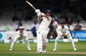 Sam Curran of England gives the ball a thwack.