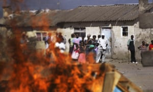 Residents in Naivasha watch a fire burn their personal belongings during ethnic clashes in the Rift Valley town in 2008.