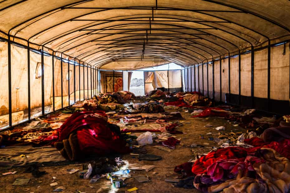 Discarded blankets, left by civilians who fled heavy fighting in the city of Baghuz, seen inside a tent at a civilian screening point set up by the SDF, on 12 February 2019