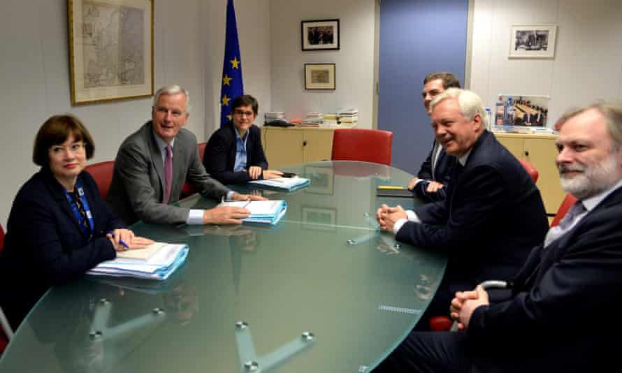 The EU's Michel Barnier and Britain's Brexit secretary, David Davis, face each other across the table.