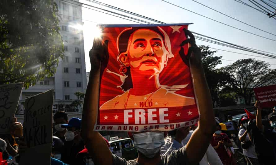 A protester in Maynmar holds up a poster calling for the release of Aung San Suu Kyi, who faces fresh corruption charges