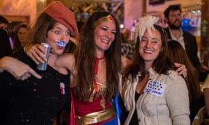 Democrats dress up including Wonder Woman at the Democrats Abroad US election night party at Marylebone Sports Bar and Grill on November 8, 2016 in London, England.