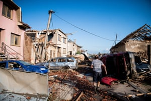 A man surveys the damage wrought by a freak tornado that swept through South Moravia region, killing three, injuring hundreds and destroying several villages in Czech Republic