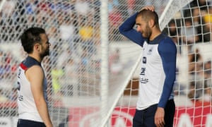 Mathieu Valbuena, left, and Karim Benzema chat during a France training session.