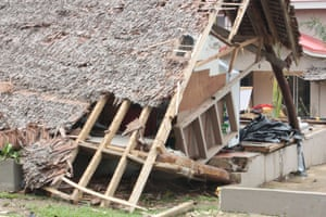 There are reports of whole villages being blown away and many homes have been destroyed, like this one in Port Vila, after Cyclone Pam ripped through the islands.