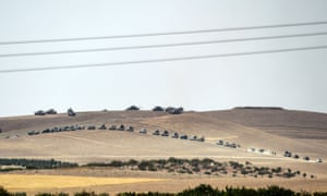 Turkish troops and pro-Ankara Syrian opposition fighters gather along the border in Karkamış