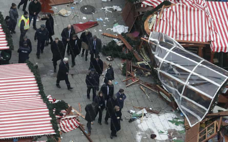 Angela Merkel visits the site of the attack.