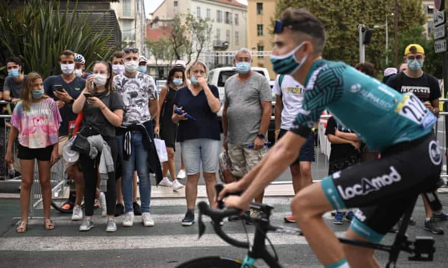 Tour de France spectators wearing face masks look on last summer