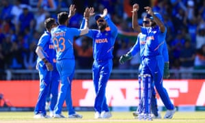 India's Jasprit Bumrah (second left) celebrates taking the wicket of West Indies' Carlos Brathwaite, caught by MS Dhoni.