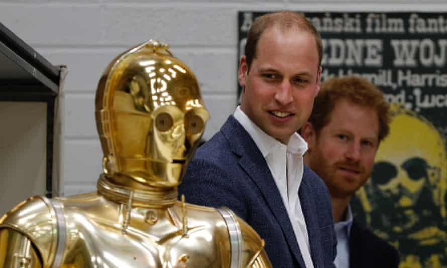 Prince William and Prince Harry look at C3P0