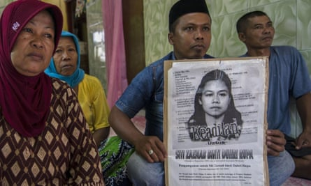 The family of the beheaded Indonesian maid Siti Zainab at their home in Bangkalan, East Java.
