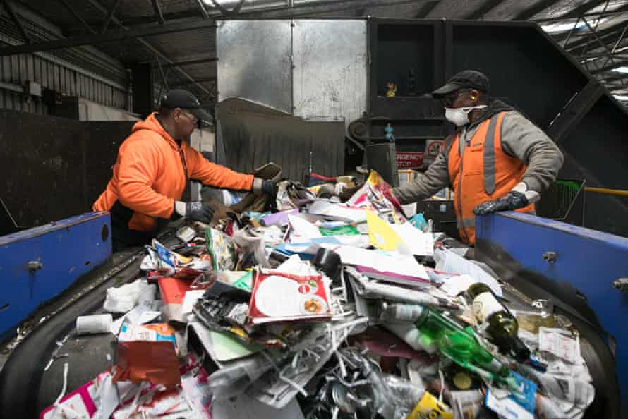 Michael Carr (left) and Johannes Bosoga (right) remove hazardous materials.