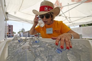 Salvation Army volunteer Jackie Rifkin tries to keep cool at she works at a special Salvation Army hydration station to help people try to keep hydrated and stay cool as temperatures climb to near-record highs