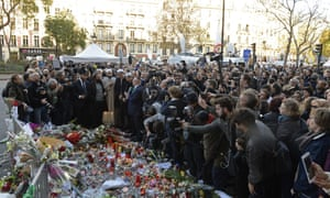 Representatives of the Jewish and Muslim communities join people gathered at the makeshift memorial near the Bataclan concert hall in Paris.