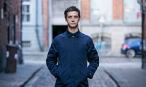Emmet Kirwan stands in a Dublin street