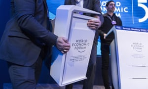 Staff clear a stage during the last day of the World Economic Forum in Davos