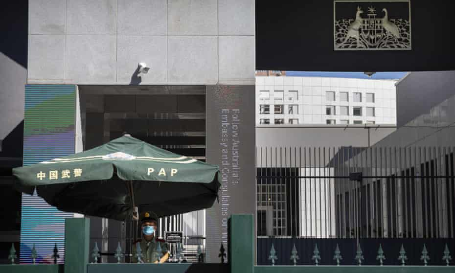 exterior of Australian embassy in Beijing manned by Chine paramilitary policeman