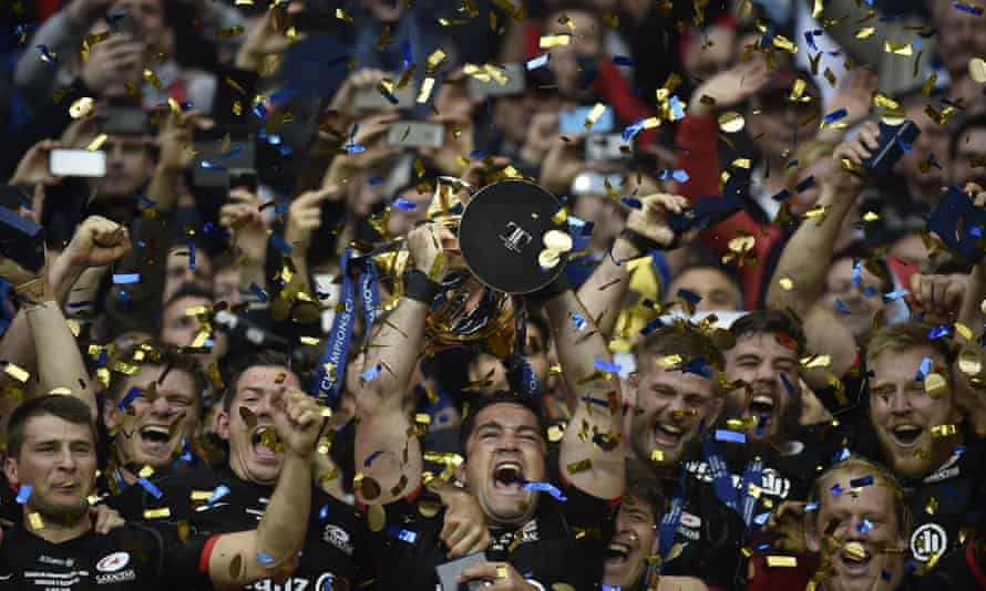 Saracens' players celebrate with the trophy after winning the European Rugby Champions Cup final against Racing 92