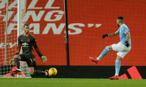 Manchester City's Riyad Mahrez is denied by David de Gea.