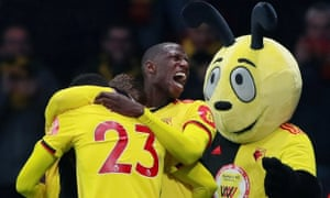 Gerard Deulofeu celebrates scoring Watford's first goal with Abdoulaye Doucouré, Ismaila Sarr – and Harry the Hornet.