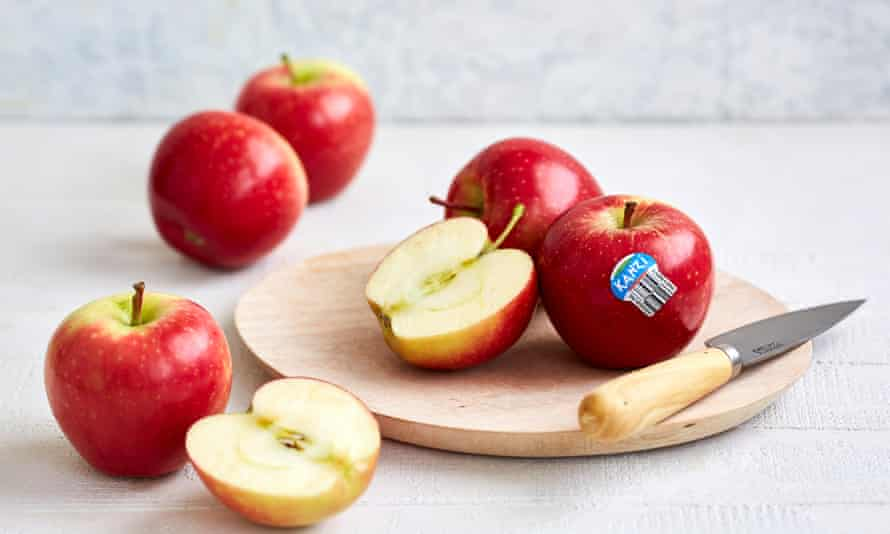 Kanzi apples on a table and cutting board