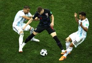 Ante Rebic of Croatia fouls Eduardo Salvio of Argentina.