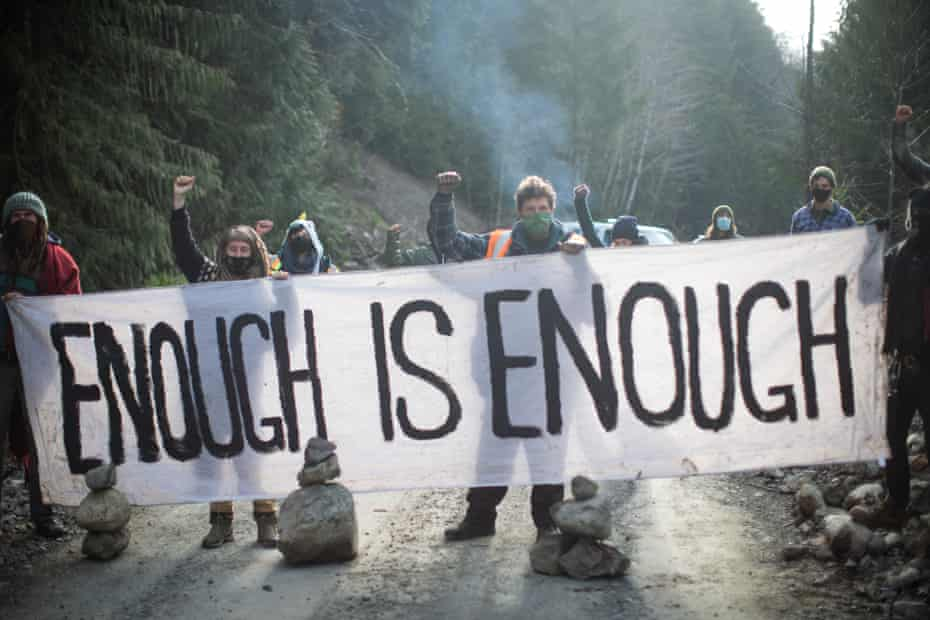 Activists block a logging road to oppose the cutting of old growth trees in the Caycuse watershed on southern Vancouver Island.