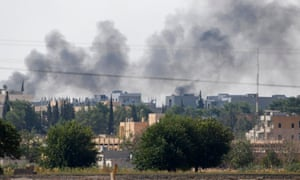 Smoke rises in the Syrian town of Kobani