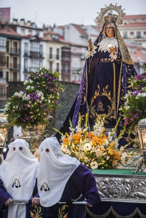 Hooded penitents during the holy week procession in Santander, Spain