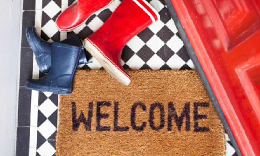 Welcome mat and wellington boots