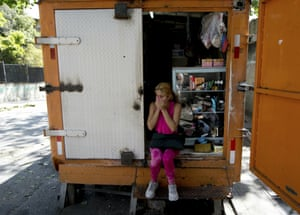 A resident of the San Jose del Avila's neighbourhood covers her nose from the lingering odor of tear gas fired by Venezuelan Bolivarian National Police a day prior.