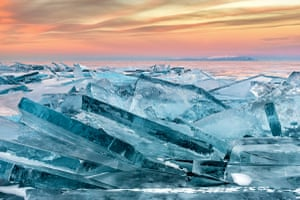 Sunset on Lake Baikal, with high ice ridges in the foreground. Lake Baikal, Russia.