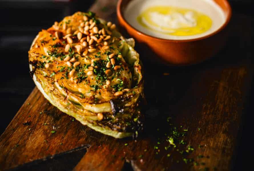 Braised hispi cabbage with garlic cream sauce.