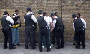 Police officers search black teenagers at Notting Hill Carnival in 2008