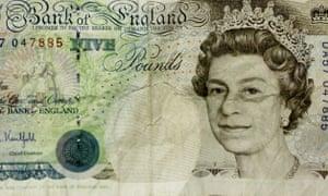 A crumpled five pound note.