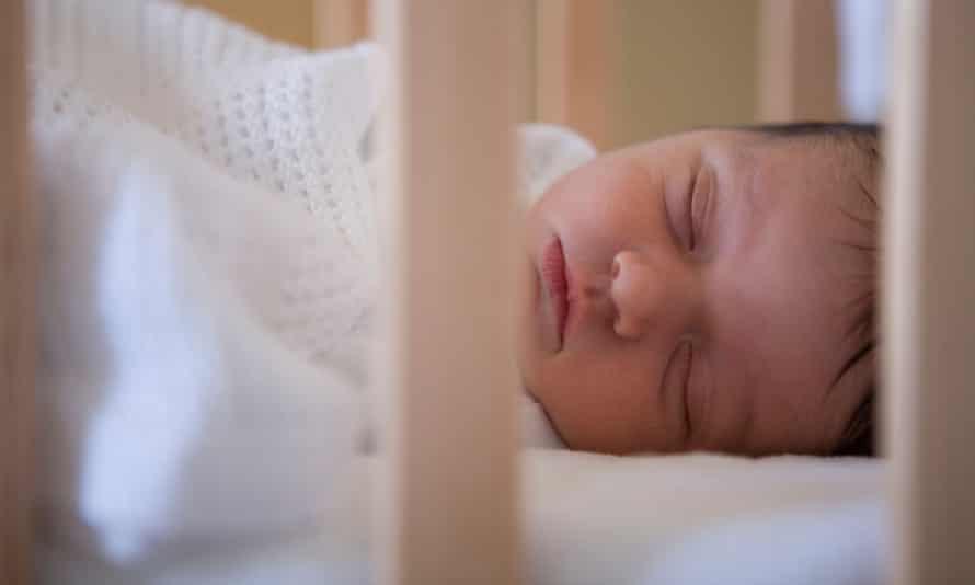 Baby asleep in cot